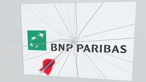 BNP PARIBAS company logo being hit by archery arrow. Business crisis conceptual Live Action