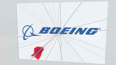 BOEING company logo being hit by archery arrow. Business crisis conceptual Live Action