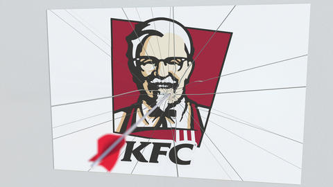 KFC company logo being hit by archery arrow. Business crisis conceptual Live Action