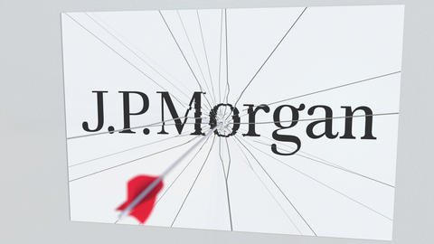 JPMORGAN company logo being hit by archery arrow. Business crisis conceptual Live Action