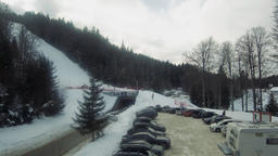 Aeiral view of skiers down the ski slope and car parking, Borovets, Bulgaria Footage