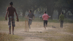 Boys playing cricket on the Maiden,Kolkata,India Footage