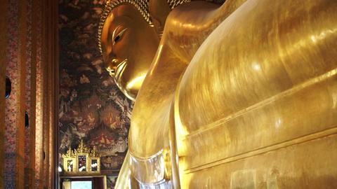 Tourist visit Sleeping Buddha, Reclining Buddha statue in Wat Pho of Bangkok, Thailand Footage