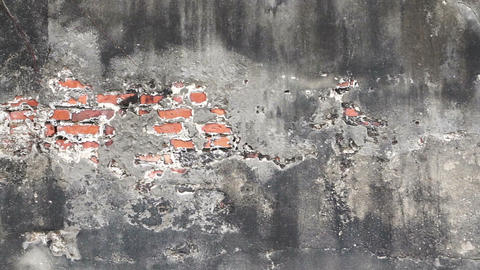 Video texture of the old destroyed concrete with brick inside wall Footage