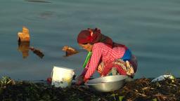 Lady washes clothes Lake in Nepal,Pokhara,Nepal Footage