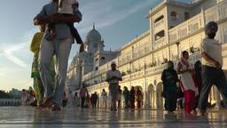 Sikh pelgrims walk around the Golden Temple,Amritsar,India Footage