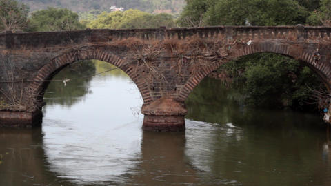 Ancient arched bridge over the river Footage
