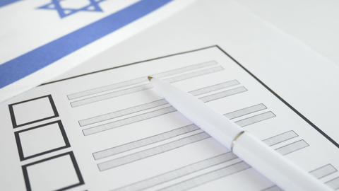 Voting ballot paper with white pen in Israel Footage