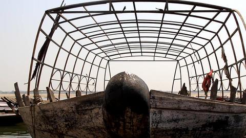 boat stands in under metal frame on water of Arabian sea Footage