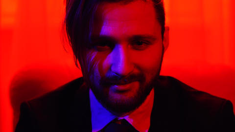 Portrait of a business bearded smiling man dressed in a business suit sitting in Footage