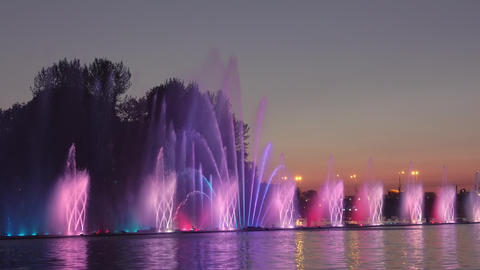Illuminated Fountain and City Sunset GIF