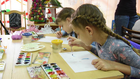 Two girls draw at their desks in the drawing lesson Footage