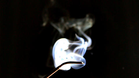 Smoke Rises from Incense Stock Video Footage