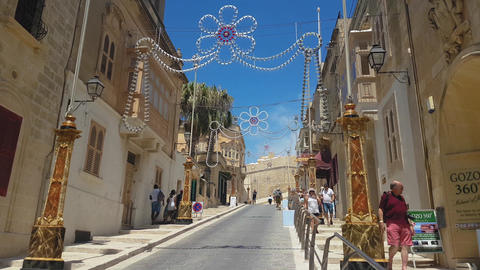 Gozo Island, Malta the road leading to Citadel fortified city acropolis Live Action