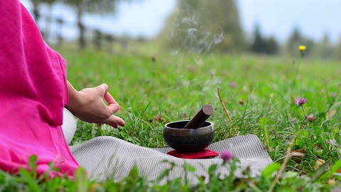 Yoga with burning incense and Tibetan bell in nature Live Action