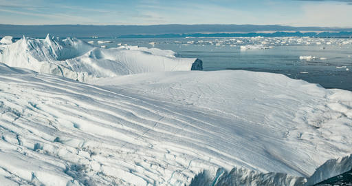 Climate Change and Global Warming - Icebergs from melting glacier on Greenland Live Action