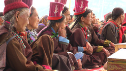 Older ladies with hat watch dance at Silk Route Festival,Sumur,India Footage