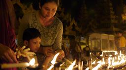Girls lighting candles at Schwedagon Pagoda,Yangon,Burma Footage