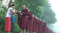 Monks on alms round early morning,Bago,Burma Footage