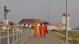 Monks walking down the Mekong shore road,Vientiane,Laos Footage