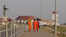 Monks walking down the Mekong shore road,Vientiane,Laos Footage