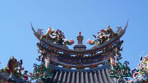 Asian Dragon on a roof in Taiwan Chinese Tao temple Footage