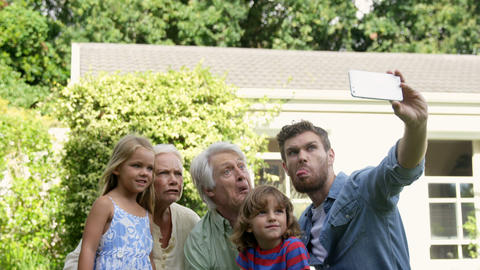 Multi-generational family taking a funny picture Live Action