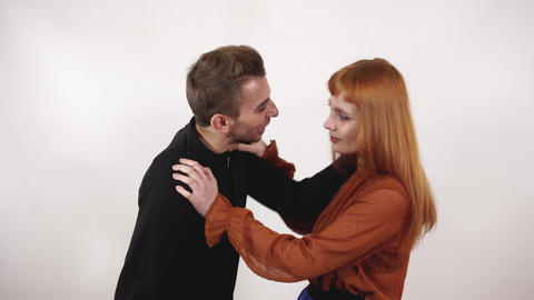 Aggressive man grabbed womans hair and yell at girl, female with long red hair Footage