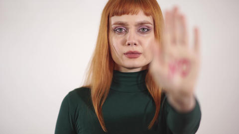 Portrait of strict young woman with written sign at her hand no Live Action