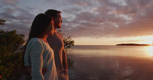 Couple in love watching sunset together on beach travel... Stock Video Footage