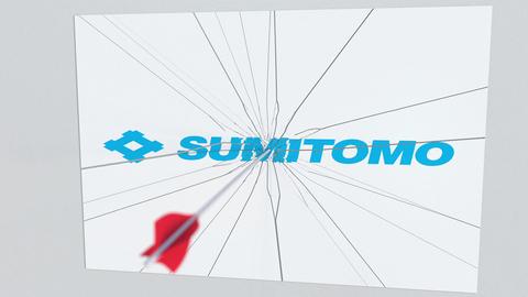 SUMITOMO company logo being hit by archery arrow. Business crisis conceptual Footage