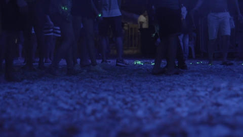 Footsteps of people dancing at the music festival Footage