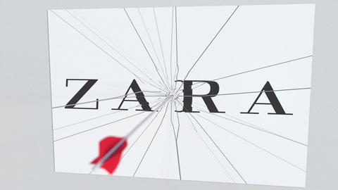 ZARA company logo being cracked by archery arrow. Corporate problems conceptual Live Action