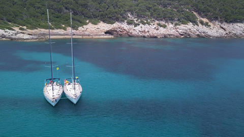 Amazing view to Yacht sailing in sea. Stock. Sunset view of the yacht. Luxury Footage
