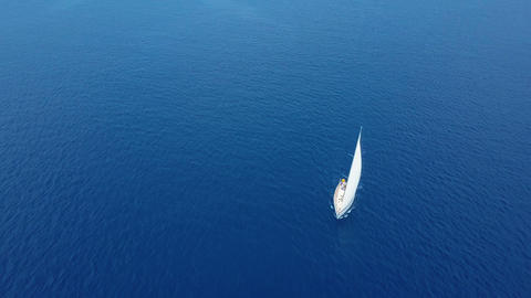 Yacht sailing on opened sea. Sailing boat. Yacht from drone. Yachting video Footage