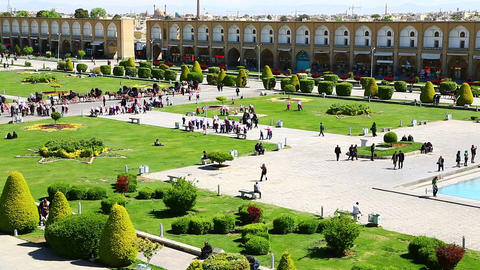 in iran the old square of isfahan prople garden tree heritage tourism and mosque Live Action