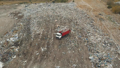 Aerial view. City dump. The garbage truck in the dump. Aerial drone shot of the Footage