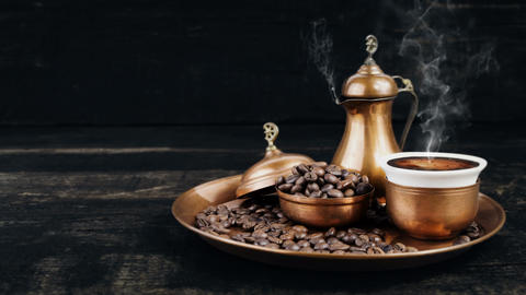 Turkish Coffee Smoking Hot In Vintage Traditional Copper Pot and Cup With Coffee Beans On The GIF