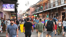 Slow motion of busy Bourbon street with people walking in New Orleans, Louisiana Footage