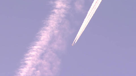 The plane crosses the contrails from another aircraft Footage