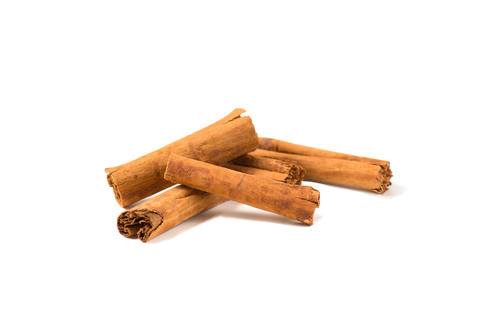 Five small fragrant cinnamon sticks overlapped with each other Photo