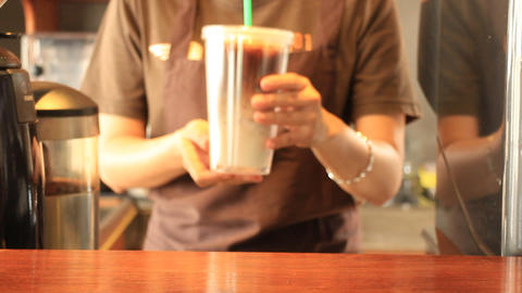 Barista Serving Doublewall Glass Of Iced Coffee Latte Live Action