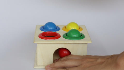 Demonstration of colorful hammer case wooden toy Live Action