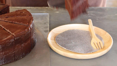 Still life of chocolate frosted cake being served Footage