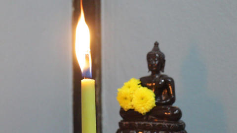 Candle light offerings to Buddha Footage