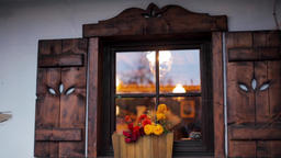 Cozy Beautiful Window with Flowers and Wooden Shutters in a Rural Country House Footage