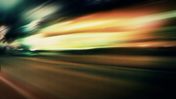 Night lights streak traveling down a city street - Street Lights 1004 HD Footage