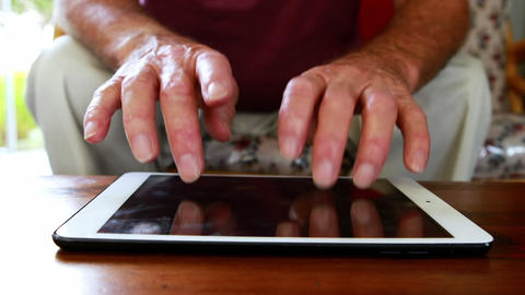 Close up view of hands using tablet pc Live Action