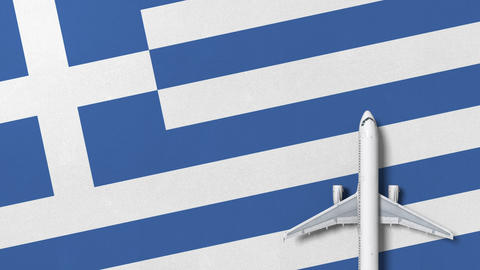 Commercial airplane on the flag of Greece. Travel related conceptual 3D Live Action