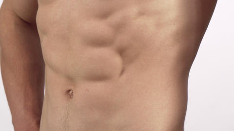 Ripped shirtless muscular men flexing his six-pack isolated Footage